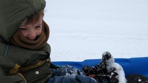 Emily photo3.child on sled.MichelleDeRusha